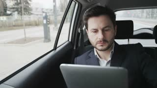 Man in a Car Checking Hour on a Watch. The Car Stops