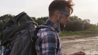 Man Touching his Hair and Eating an Apple in the Wild