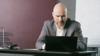 Middle-Aged Businessman Starting His Work in a Hurry