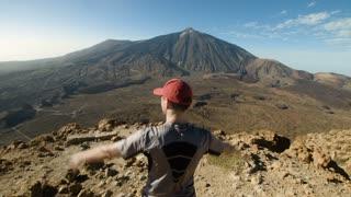 Mountain Peak. Man Standing and Raising His Hands