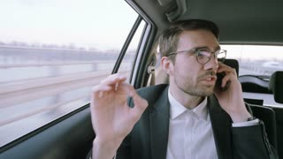 Nervous Young Businessman Showing the OK Gesture