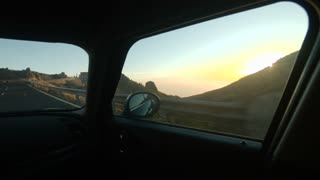 Passenger Car Moving Straight in the Sunlight