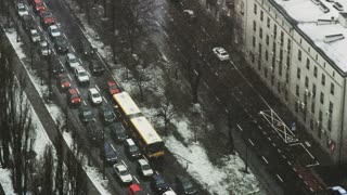 Passenger Cars and a Bus Stuck in a Traffic Jam
