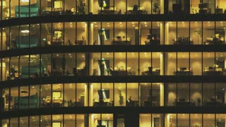 People in Tall Office Building. Camera Moving Down