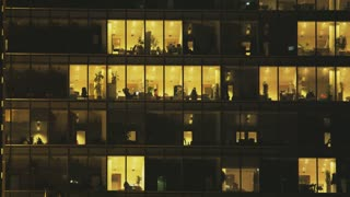 People Working in Office Building in the Winter Evening