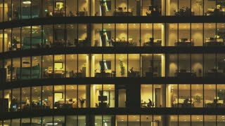 People Working in Tall Office Building