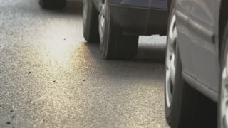 Shining Road Surface. Cars Moving Slowly in a Traffic Jam