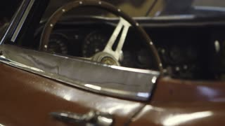 Steering Wheel and Engine of Classic Jaguar E-Type Car. Car Ready to Restore
