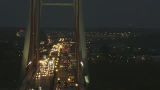 Vehicles Moving Slowly Through a Bridge. Large Traffic Jam