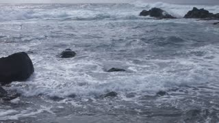 Waves Hitting Small Rocks on the Shore