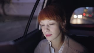 Woman in the Car Looking Carefully Through a Window