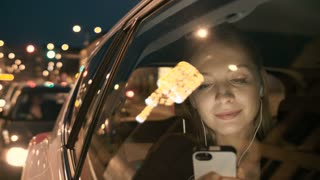 Woman Touching Hair and a Headphone. The Car Moves Off