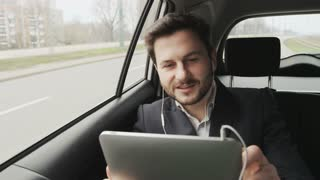 Young Businessman in the Car Having a Nice Skype Call