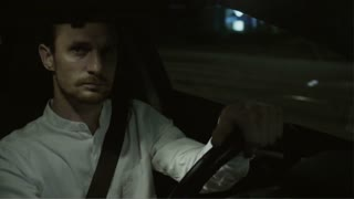 Young Businessman Looking Around While Driving Straight
