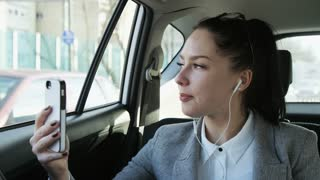 Young Businesswoman Having a Nice Phone Call in the Car