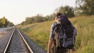 Young Man Losing his Balance on Railway Tracks