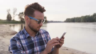 Young Man Using a Mobile in the Wild