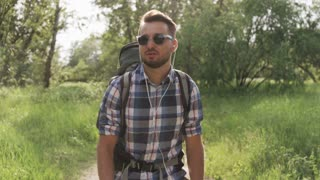 Young Man With Dark Glasses Walking in the Woods