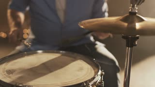 Young Percussionist Playing a Drum Set With Drum Brushes