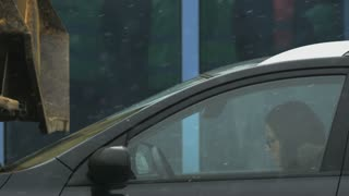Young Woman in Glasses Feeling Sleepy in her Black Car