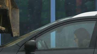 Young Woman in Glasses Feeling Sleepy in her Black Car