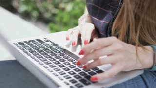 Young Woman Using a Touchpad. Only her Hands are Visible