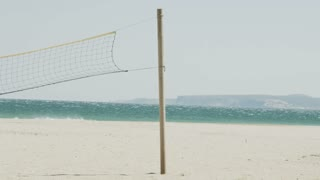 Volleyball net on the beach on a windy day in slow motion