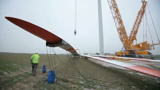 Wind Turbine Element Lifted by a Crane. Time-lapse