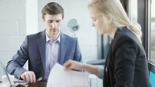 Woman Gives Documents to Sign and Makes a Deal
