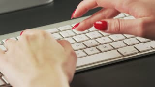 Woman Typing on a Keyboard and Making Gestures