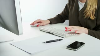 Woman Using Mouse and Typing on a Keyboard