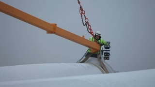 Worker Tying Rotor Blade With a Rope