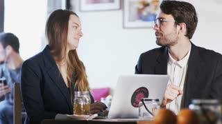 Young Business People Look Into Each Other's Eyes