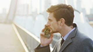 Young Businessman Being Outdoors and Angry While Talking on the Phone
