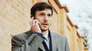 Young Businessman Being Outdoors and Frustrated During a Phone Call