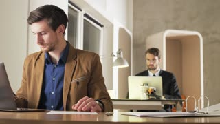 Young Businessman Checking Hour and Leaving the Office