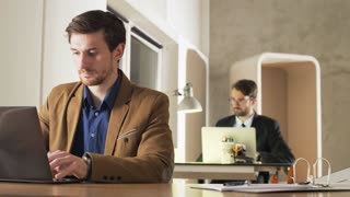 Young Businessman Feeling Distracted During Work