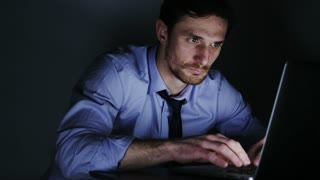 Young Businessman Focused on Work During Overtime