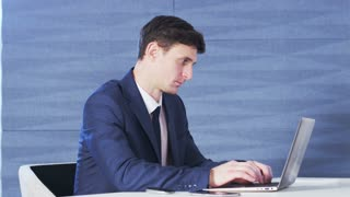 Young Businessman Focused on Work