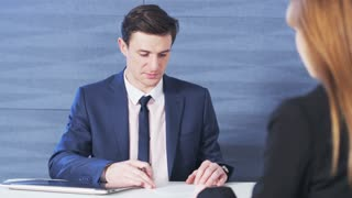Young Businessman gives a paper to his workmate