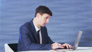 Young Businessman Happy While Looking at a Computer