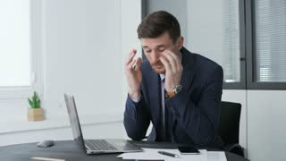 Troubled young businessman in an office.