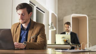 Young Businessman Tired During Work