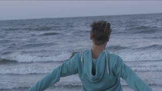 Young Man Standing at a Seashore