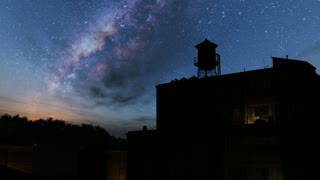 buildings of old town and Milky Way stars at night. Elements of this image furnished by NASA