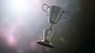 Champion trophy cup on bokeh background with light