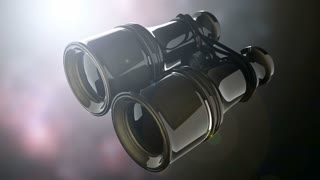 Old military binoculars on bokeh background with light