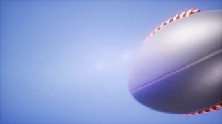 4K Super slow motion flying football on blue sky background