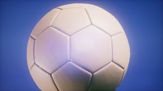 4K Super slow motion flying soccer ball on blue sky background