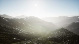 Aerial video of mountains in fog at sunset